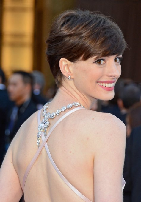 Anne Hathaway's necklace intrigued me. At first I thought it was a long necklace bunched in the back. After see this picture, I can tell it was designed to cross over. My guess, the cross over was originally designed for the front.