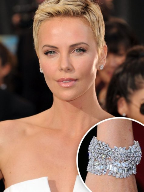 "Charlize Theron gets the Krombholz Jewelers ""Stack Award"" for her bracelet combo. Nothing like adding a few hundred carats of diamonds on your wrist."