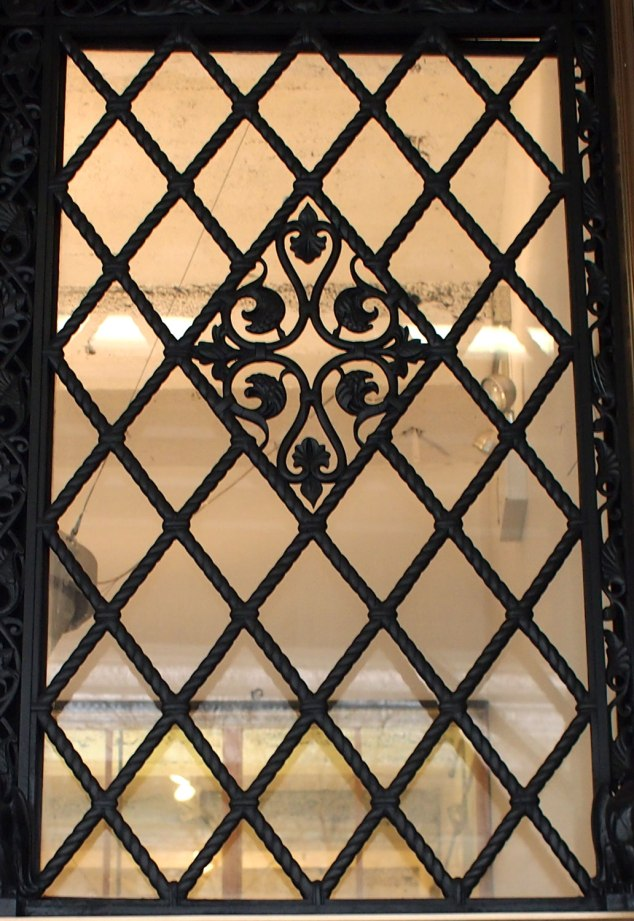 I like this trellis style wrought iron with the centered ornament